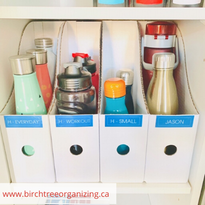 Canva water bottles - ORGANIZING FAVOURITES: 20 WAYS TO ORGANIZE WITH MAGAZINE HOLDERS