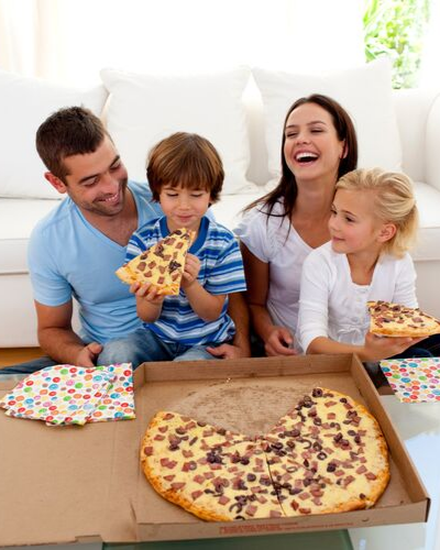 Family eating pizza - 15 Tips To Make Moving With Kids Easier
