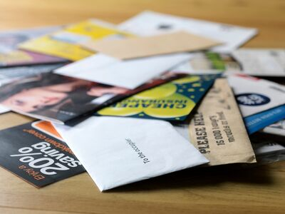 pile of mail - HOW TO QUICKLY SORT THROUGH PAPER CLUTTER