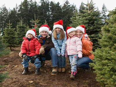 Family with trees - 10 Things To Do NOW To Prepare For The Holidays