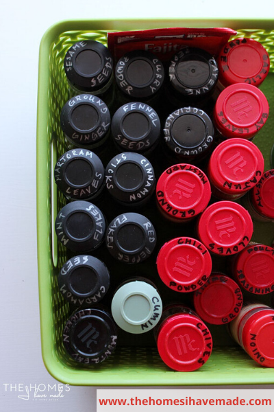 Canva bottles in basket - 26 EASY WAYS TO ORGANIZE YOUR SPICES