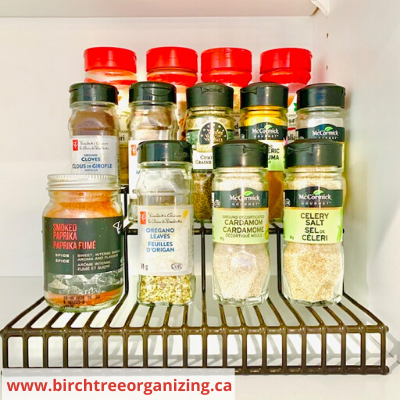 Canva tiered rack - 26 EASY WAYS TO ORGANIZE YOUR SPICES