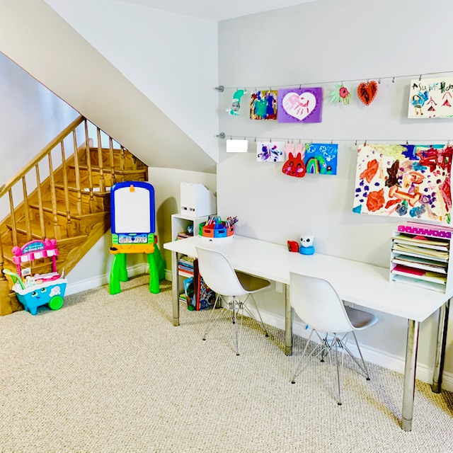 Canva from couch after - PLAYROOM