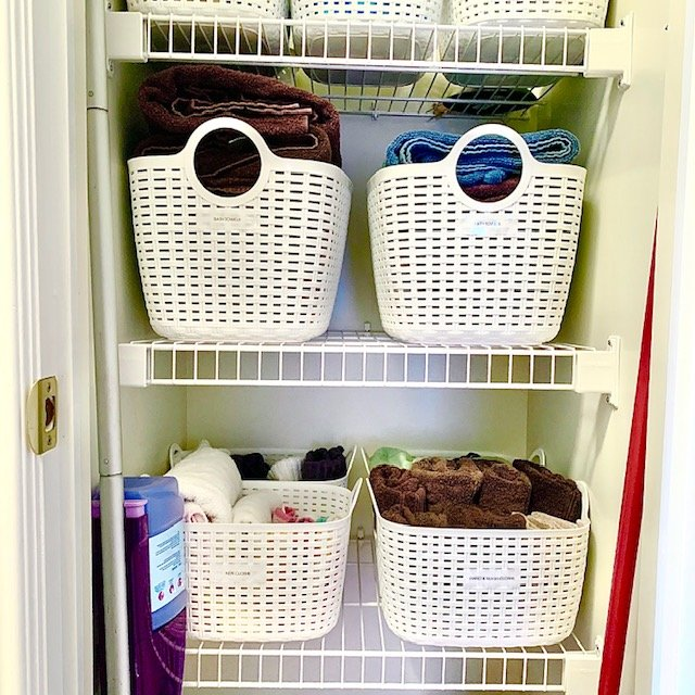 After middle shelves - Small Multi-Use Linen Closet Before and After Pictures