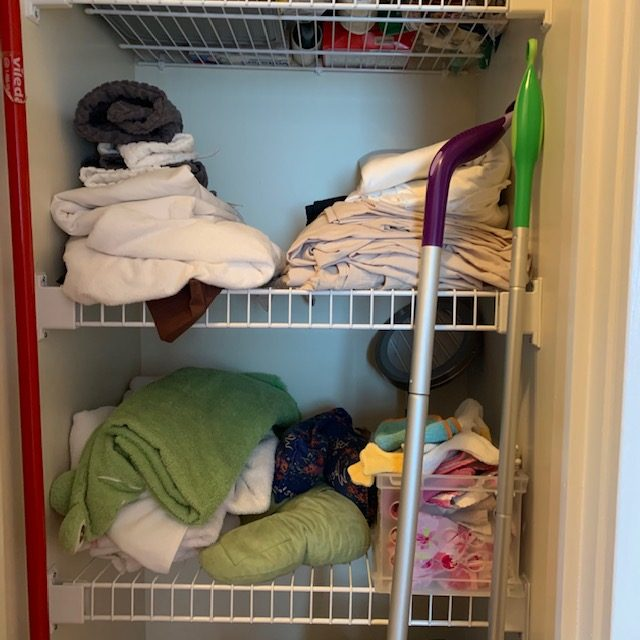 Before middle 2 shelves rotated - Small Multi-Use Linen Closet Before and After Pictures