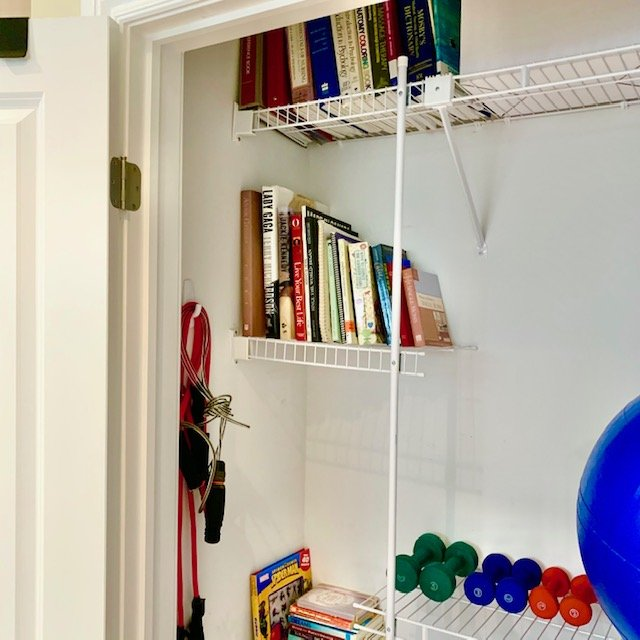 after upper side shelves and workout stuff on wall - Reach-In Storage Closet Before and After Pictures