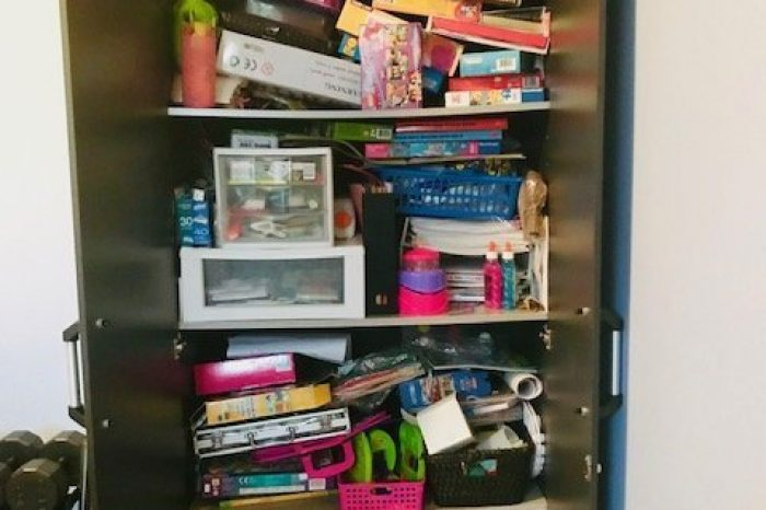 Before picture: Over-crowded toy cupboard